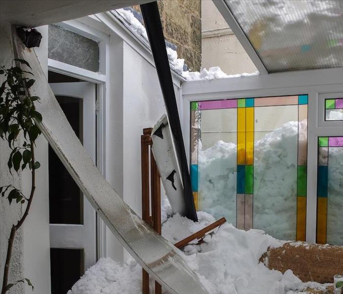 snow storm damaged home.