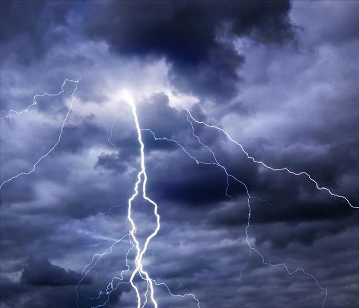 Lighting strikes in dark stormy clouds